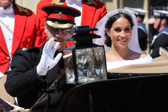 Meghan Markle (R), pictured with Prince Harry, will support her patronages with tours this month. File Photo by Hugo Philpott/UPI
