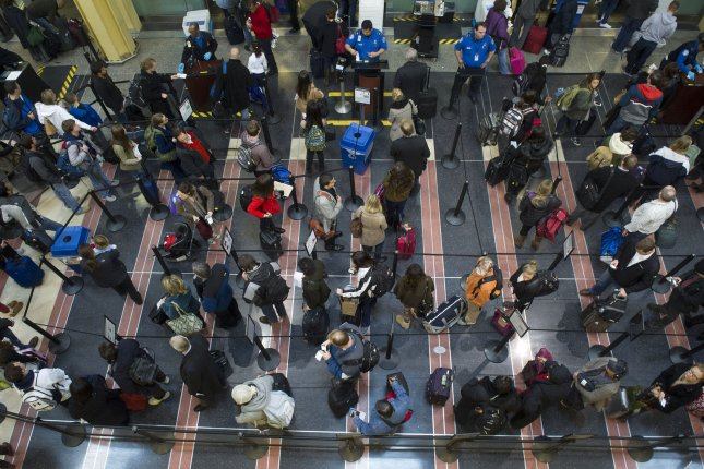 Travelers wait at a security checkpoint at Ronald Reagan National airport in Arlington, Va. File Photo by Kevin Dietsch/UPI