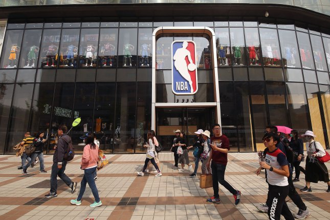 Pedestrians walk near the largest NBA store outside of North America in Beijing, China, on April 19. File Photo by Stephen Shaver/UPI