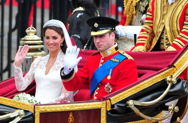 Prince William and Princess Catherine leave Westminster Abbey in a carriage following their wedding ceremony in London on April 29, 2011. The former Kate Middleton married Prince William in front of 1,900 guests. The couple will now go by the Duke and Duchess of Cambridge. UPI/Kevin Dietsch