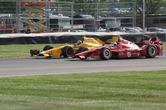 Ryan Hunter-Reay (28) edges ahead of Scott Dixon in turn 7 midway during Grand Prix of Indianapolis at the Indianapolis Motor Speedway on May 9, 2015 in Indianapolis, In. Photo by Amanda Frederick/UPI