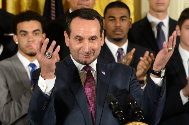 Duke head basketball coach Mike Krzyzewski asks everyone to stand to honor President Barack Obama during a celebration event in the East Room of the White House in Washington, DC on September 8, 2015. The Duke Blue Devils won the NCAA college basketball championship in March of 2015. Photo by Pat Benic/UPI