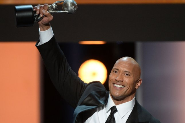 Dwayne 'The Rock' Johnson accepts the award for Entertainer of the Year onstage at the 48th NAACP Image Awards on February 11. The Rock made a suprise phone call to former WWE Superstar CM Punk following Raw. Photo by Jim Ruymen/UPI
