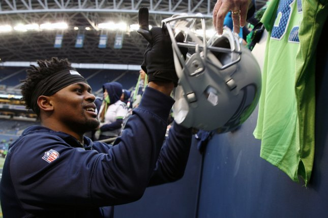 Seattle Seahawks running back C.J. Prosise (22) autograph a helmet before their NFL playoff Wild Card game against the Detroit Lions at CenturyLink Field in Seattle, Washington on January 7, 2017. File photo by Jim Bryant/UPI