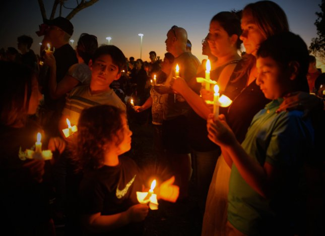 The community gathers for a candlelight vigil at Parkland Amphitheater for the Marjory Stoneman Douglas High School, shooting victims on February 15, 2018 in Parkland, Florida. A former student is in custody after 17 students are reported dead. Photo by Gary Rothstein/UPI