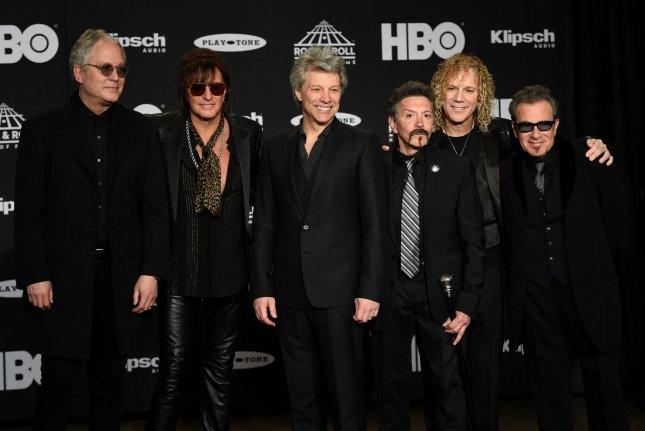 Members of the group Bon Jovi pose for a photo back stage at the 33rd annual Rock and Roll Hall of Fame induction ceremonies at Public Hall on Saturday in Cleveland. Photo by Scott McKinney/UPI