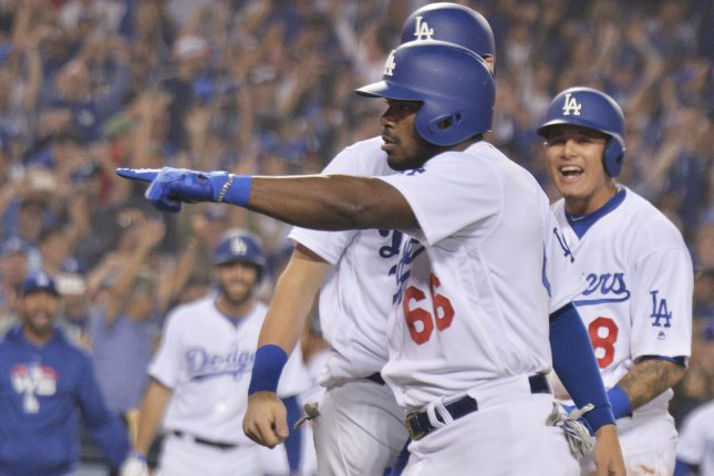 Los Angeles Dodgers right fielder Yasiel Puig celebrates his three-run home run against the Boston Red Sox during the sixth inning in Game 4 of the MLB 2018 World Series on October 27 at Dodger Stadium in Los Angeles. Photo by Jim Ruymen/UPI