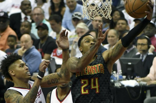 Atlanta Hawks forward Kent Bazemore (24) averaged 11.6 points and 3.9 rebounds per game last season. He was traded to the Portland Trail Blazers for Evan Turner. File Photo by Mark Goldman/UPI