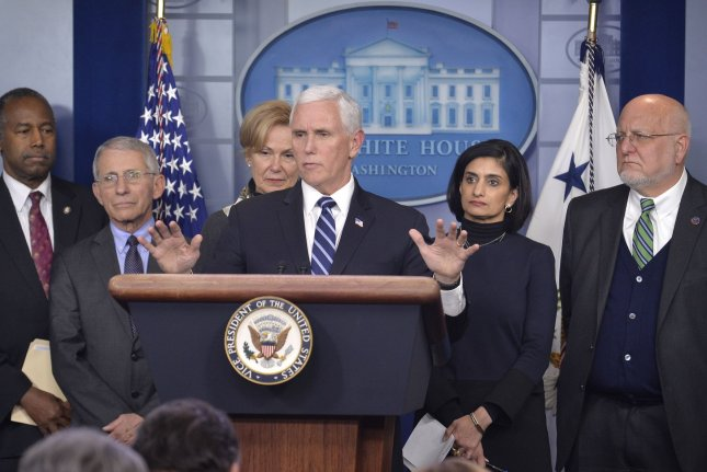 Vice President Mike Pence (C), who is leading federal efforts to contain coronavirus, speaks during a press briefing Wednesday at the White House, surrounded by other federal health officials.  Photo by Mike Theiler/UPI