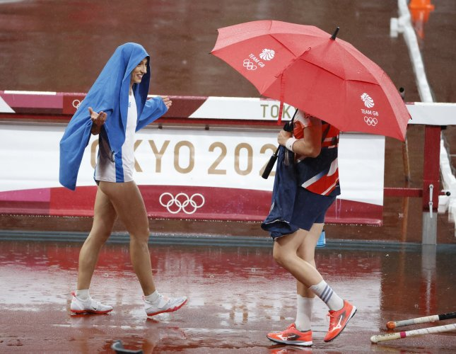 Athletes enjoy a downpour of rain at Olympic Stadium during the 2020 Summer Olympics in Tokyo on Monday. A tropical storm could bring more rain to the city. Photo by Tasos Katopodis/UPI