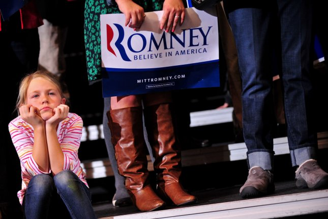 A young girl attends a rally for Republican Presidential candidate Mitt Romney in North Charleston, South Carolina during the Republican primary elections on January 20, 2012. UPI/Kevin Dietsch