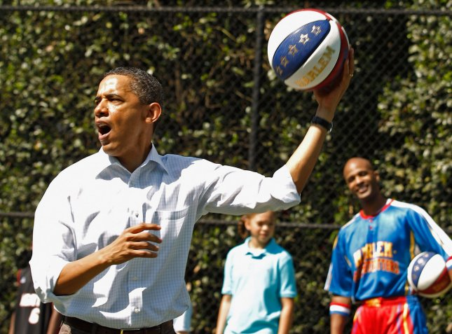 U.S. President Barack Obama shoots a basketball while participating in a Let's Move clinic with members of the NBA, WNBA and the Harlem Globetrotters during the White House Easter Egg Roll on the South Lawn of the White House April 25, 2011 in Washington, DC. UPI/Chip Somodevilla/POOL