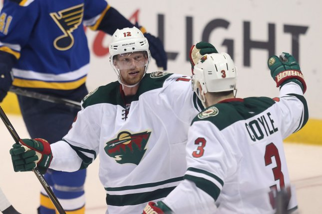 Minnesota Wild Eric Staal (12) skates in to celebrate Charlie Coyle's goal with him against the St. Louis Blues in the first period at the Scottrade Center in St. Louis on April 19, 2017. Photo by Bill Greenblatt/UPI