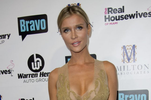 Joanna Krupa attends the Real Housewives of Miami Season 3 premiere on August 6, 2013. The television personality finalized her divorce from Romain Zago on Thursday. File Photo by Gary I. Rothstein/UPI