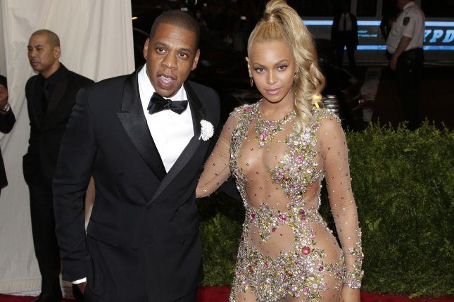 Jay-Z (L) with Beyonce. The rapper will be headlining Woodstock 50 alongside The Killers and Miley Cyrus. File Photo by John Angelillo/UPI