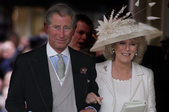 Prince Charles leaves Windsor's Guildhall following his marriage to Camilla Parker Bowles on April 9, 2005. File Photo by Hugo Philpott/UPI