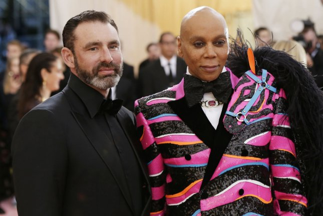 RuPaul (R) and his husband Georges LeBar at the Met Gala Monday. RuPaul said on The Late Show that drag is to help understand that life shouldn't be taken so seriously. Photo by John Angelillo/UPI