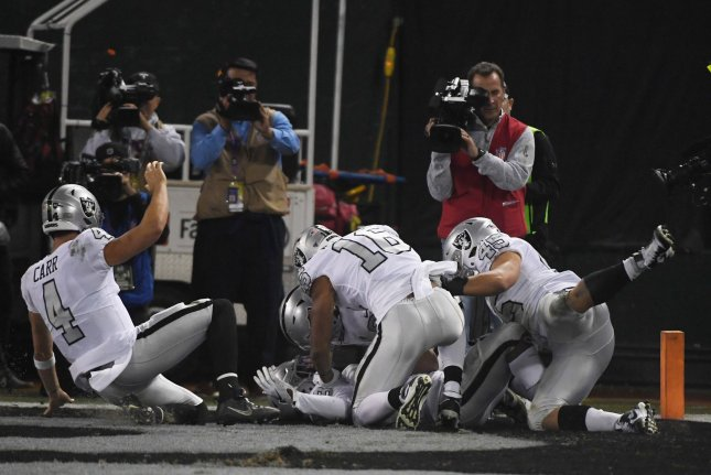 Oakland Raiders quarterback Derek Carr (4) completed 21 of 31 passes for 218 yards and a score in a win against the Los Angeles Chargers Thursday in Oakland. Photo by Terry Schmitt/UPI