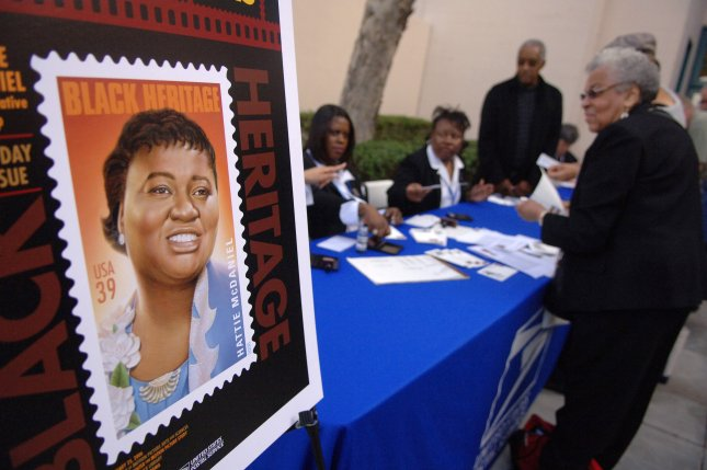 Stamps and memorabilia are for sale at the dedication of a new 39-cent commemorative stamp honoring actress Hattie McDaniel held at the The Academy of Motion Picture Arts and Sciences Fairbanks Center for Motion Picture Study in Beverly Hills, Calif., on January 25, 2006. On February 29, 1940, McDaniel became the first African-American actor to win an Academy Award -- for her role in Gone With the Wind. The movie won eight awards that night. File Photo by Phil McCarten/UPI