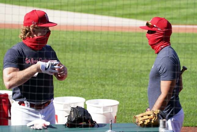 St. Louis Cardinals outfielder Harrison Bader (L) talks with bench coach Oliver Marmol during batting practice Thursday at Busch Stadium in St. Louis. The Cardinals announced Friday that two more players and a staff member tested positive for the coronavirus. Photo by Bill Greenblatt/UPI