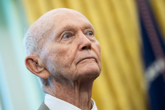 Apollo 11 astronaut Michael Collins listens as President Donald Trump delivers remarks as he and fellow Apollo 11 astronaut, Buzz Aldrin, and family members of the late Neil Armstrong, are welcomed to the Oval Office at the White House in Washington, D.C., on July 19, 2019. Collins turns 90 on October 31. File Photo by Kevin Dietsch/UPI