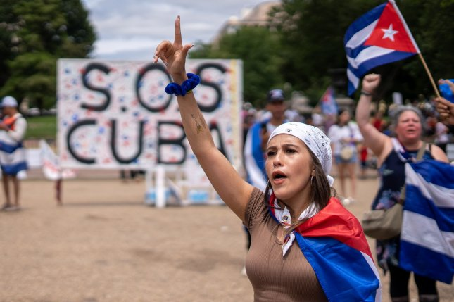 Marisol, (no last name given), protests the lack of freedom and a worsening economy in her homeland of Cuba while in front of the White House in Washington, D.C., on Sunday. Photo by Ken Cedeno/UPI