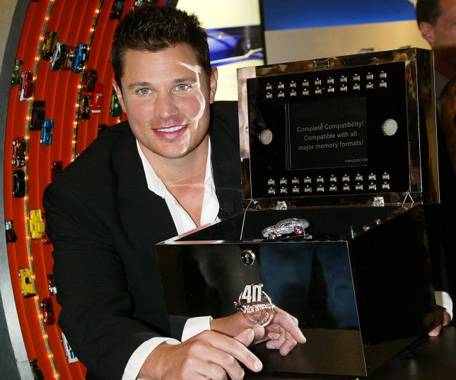 Singer Nick Lachey poses with the new custom jeweled diamond encrusted Hot Wheels car designed by Jason of Beverly Hills to commemorate the production of the four billionth Hot Wheels vehicle and the 40th anniversary of Hot Wheels cars at the Mattel Showroom in New York on February 15, 2008. (UPI Photo/Laura Cavanaugh)