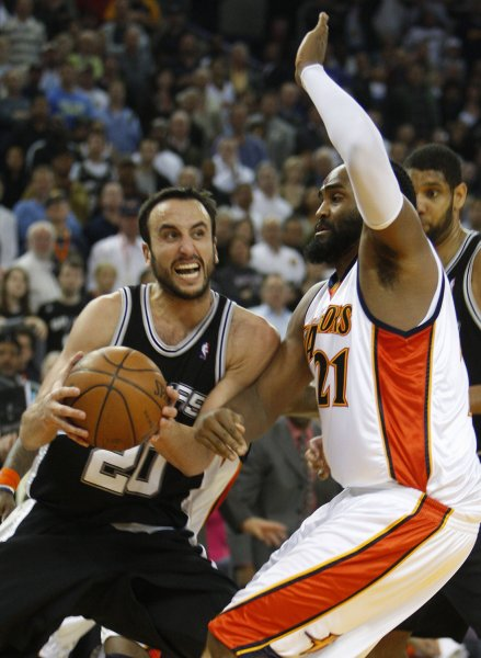 The San Antonio Spurs' Manu Ginobili (20) drives on the Golden State Warriors' Ronny Turiaf in a Feb. 3, 2009 game. (UPI Photo/ Terry Schmitt)