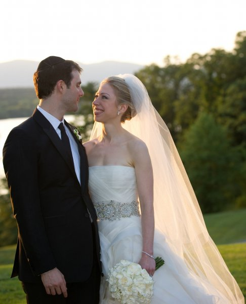 Chelsea Clinton, daughter of former President Bill Clinton and Secretary of State Hillary Clinton, and her husband Marc Mezvinsky walk down the aisle after their wedding ceremony at Astor Court in Rhinebeck, New York on July 31, 2010. (One Time Editorial Use Only) UPI/Barbara Kinney/HO