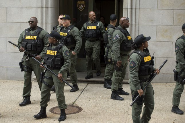 Baltimore-area taxpayers will cover an estimated $7.5 million in law enforcement costs related to the trials of police officers acquitted in the death of Freddie Gray. Pictured: A group of sheriff's deputies guard a door at the courthouse after Baltimore City police officer Caesar Goodson was acquitted of all charges for his involvement in the Freddie Gray arrest and death, in Baltimore, Maryland on June 23. Goodson was the driver of the transport van in which Gray suffered his fatal spinal injury and later died in April 2015. Photo by Kevin Dietsch/UPI
