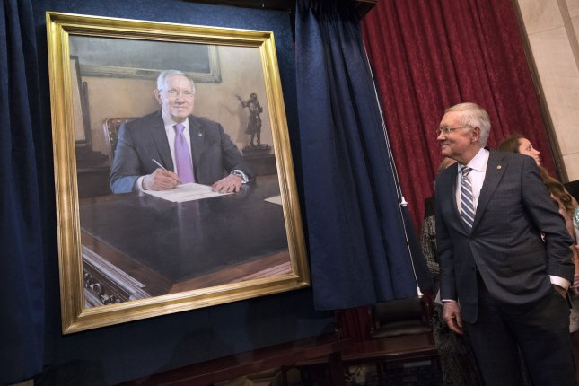 Senate minority leader Harry Reid, D-Nev., gazes at his portrait during an unveiling ceremony at the U.S. Capitol in Washington, D.C., on Thursday. The five-term senator from Searchlight, Nev., who leaves office in January, delivered a farewell address on the Senate floor on Thursday. Photo by Kevin Dietsch/UPI