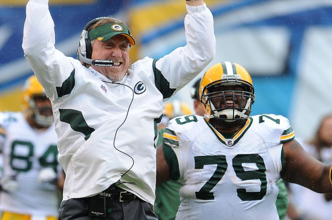 Green Bay Packers defensive end Ryan Pickett (79) and former linebacker coach Kevin Greene cheer after the second interceptioin and touchdown run in the first quarter of the game at Qualcomm Stadium in San Diego, California on November 6, 2011. UPI/Jayne Kamin-Oncea