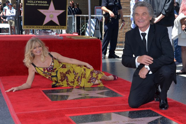 Goldie Hawn and Kurt Russell pose beside their respective stars during a double star unveiling ceremony honoring them with the 2,609th and 2,610th stars on the Hollywood Walk of Fame in Los Angeles on Thursday, 2017. Photo by Jim Ruymen/UPI