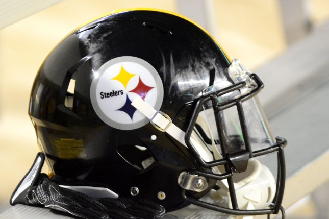 A Pittsburgh Steelers helmet is seen on the bench at Heinz Field in Pittsburgh on August 30. Pittsburgh beat Tampa Bay 30-27 Monday night despite a late comeback attempt led by quarterback Ryan Fitzpatrick. Photo by Archie Carpenter/UPI