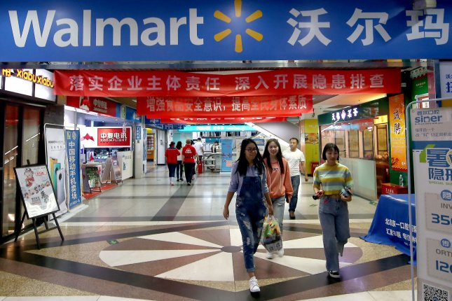 Shoppers are seen at a Walmart Supercenter store in Beijing, China. The retailer said in an earnings report Tuesday that sales overseas declined in the second quarter by almost 7%. File Photo by Stephen Shaver/UPI