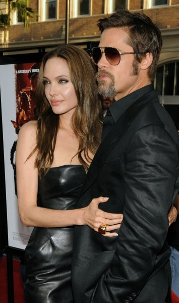 Brad Pitt, a cast member in the motion picture war drama Inglourious Basterds and actress Angelina Jolie attend the premiere of the film at Grauman's Chineses Theatre in Los Angles on August 10, 2009. UPI/Jim Ruymen