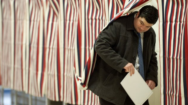 A voter casts their ballot on primary election day on January 10, 2012. UPI/Kevin Dietsch
