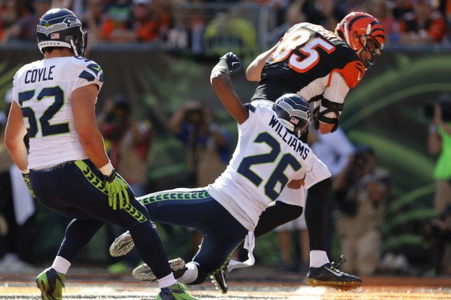 Cincinnati Bengals tight end Tyler Eifert (85) runs in for the touchdown under pressure from Seattle Seahawks' Cary Williams (26) during the second half of play at Paul Brown Stadium in Cincinnati, Ohio, October 11, 2015. Photo by John Sommers II/UPI