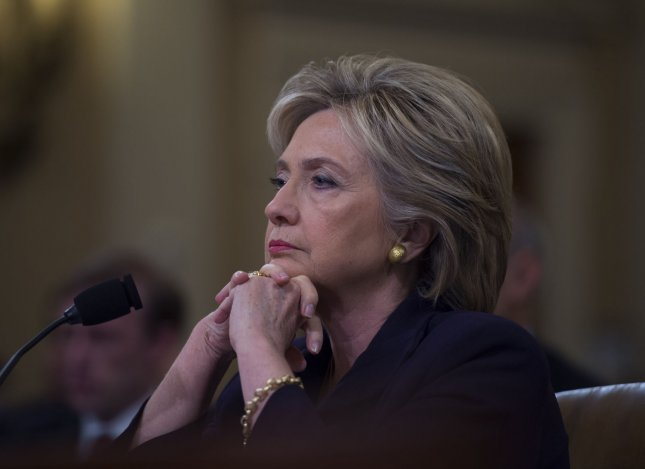 Former Secretary of State and Democratic presidential hopeful Hillary Clinton listens to opening statements while testifying before the Select Committee on Benghazi on Capitol Hill in Washington D.C., October 22, 2015. Photo by Molly Riley/UPI
