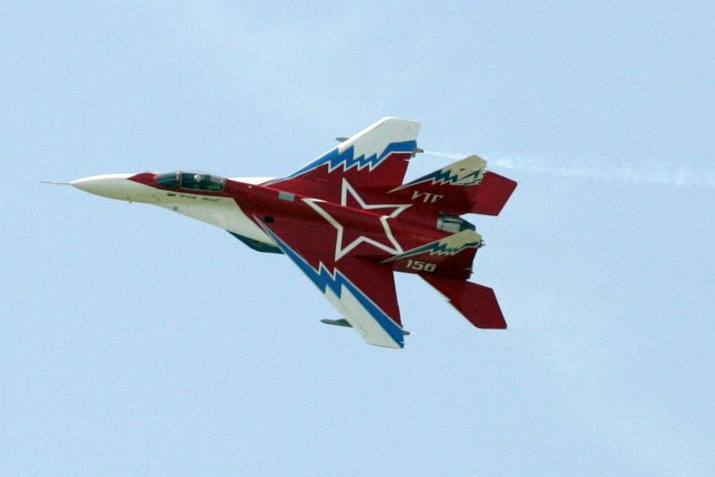 Bulgaria will spend $1.4 billion to revamp its air and naval forces, including new purchases as well as modernization of its Mig 29 fleet. Pictured, smoke billows from the wingtips of a Mig 29 at the Paris Air Show in Le Bourget airport, June 19, 2007. File photo by Eco Clement/UPI