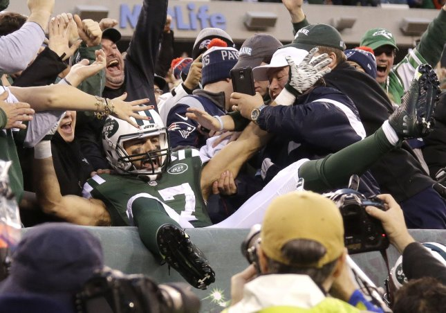 Better days: New York Jets wide receiver Eric Decker leaps into the seats and celebrates with fans after catching a game-winning touchdown pass in overtime against the New England Patriots on Dec. 27. Photo by John Angelillo/UPI