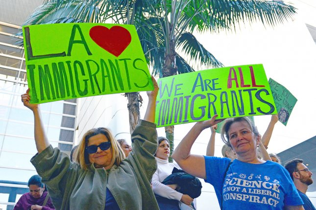 Protesters rally against President Donald Trump's immigration order -- which barred entry by refugees of majority-Muslim countries -- on January 29 in front of the Tom Bradley Terminal at the Los Angeles International Airport in Los Angeles. The California Senate voted Monday to pass a bill focusing on a different group of immigrants -- those without documentation. The bill declares California a sanctuary state, meaning it will not help federal immigration enforcement unless dealing with undocumented immigrants convicted of a prior violent crime. Photo by Christine Chew/UPI