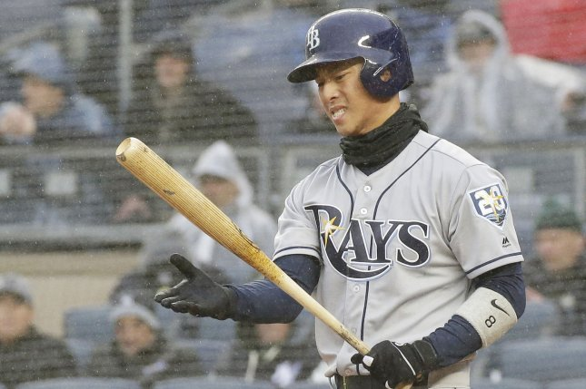 Tampa Bay Rays' Rob Refsnyder reacts after a swing in the third inning against the New York Yankees in the Yankees home opener on April 3 at Yankee Stadium in New York City. Photo by John Angelillo/UPI