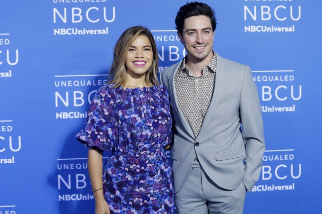 Ben Feldman (R), pictured with America Ferrera, announced wife Michelle Feldman's pregnancy Tuesday on Election Day. File Photo by John Angelillo/UPI