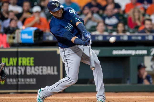 Nelson Cruz of the Seattle Mariners hits an RBI single against the Houston Astros in the 5th inning on September 19 at Minute Maid Park in Houston. Photo by Trask Smith/UPI