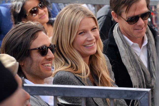 Gwyneth Paltrow (C) explained why she remained close to Chris Martin after they ended their marriage. File Photo by Jim Ruymen/UPI