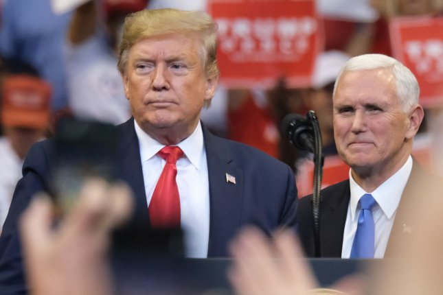 President Donald Trump stands with Vice President Mike Pence on November 26 before speaking to supporters in Sunrise, Fla. Photo by Gary I Rothstein/UPI