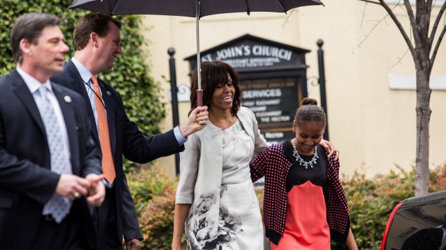 First Lady Michelle Obama walks with his daughter Sasha after the First Family attended an Easter church service at St John's Episcopal Church in Washington, DC on March 31, 2013. UPI/Drew Angerer/Pool