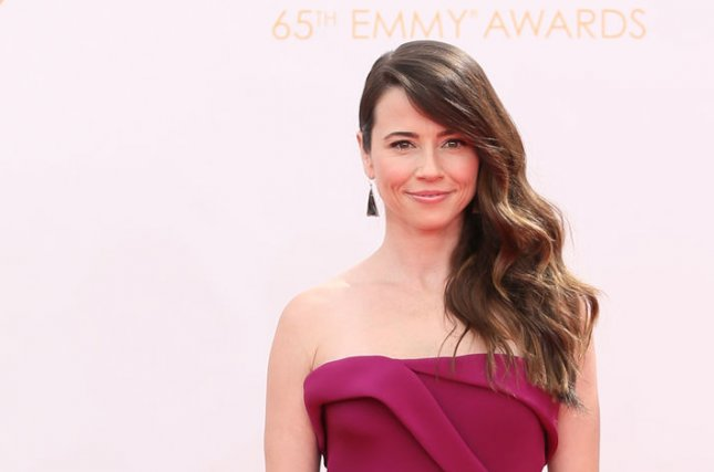 Actress Linda Cardellini arrives for the 65th Primetime Emmy Awards at Nokia Theatre in Los Angeles on September 22, 2013. UPI/Danny Moloshok