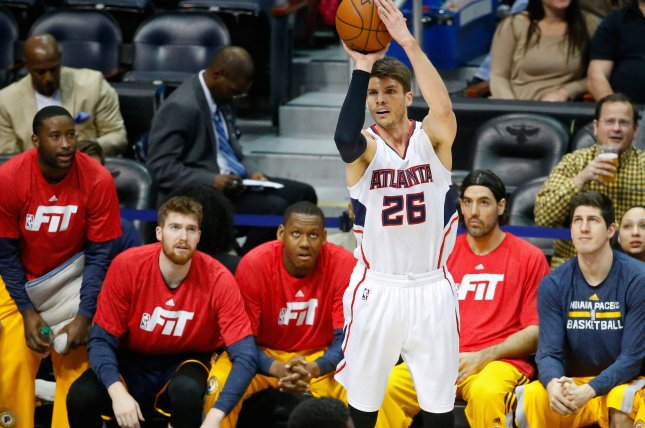 Atlanta Hawks' Kyle Korver (26) shoots a three-point basket over Indiana Pacers' Roy Hibbert (55) during the first half of their NBA game at Philips Arena in Atlanta, January 21, 2015. Korver had 10 points in Atlanta's 110-91 victory over Indiana which tied a team-record 14 wins in a row. Photo by David Tulis/UPI